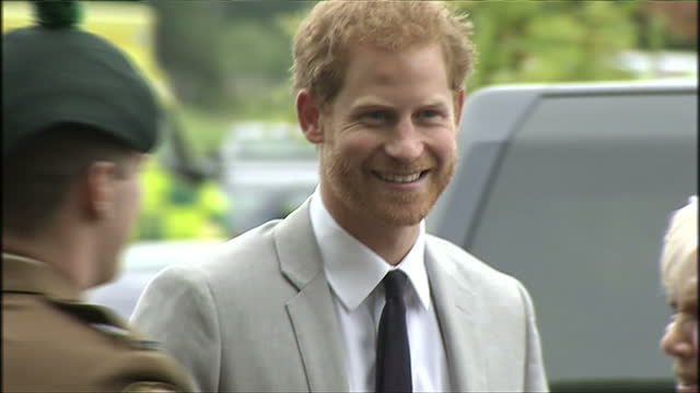Various shots of Prince Harry arriving to open a new ambulance station in Ballymena and greeting officials and members of staff on September 07 2017...