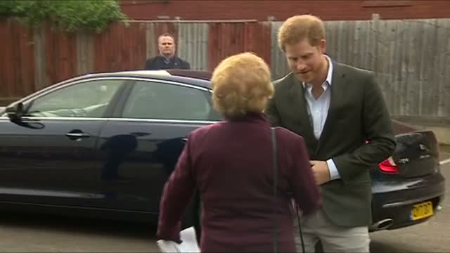 various shots of prince harry arriving to visit the pink lizard youth and community organisation and meeting local officials and community leaders on... - youth organisation stock videos & royalty-free footage