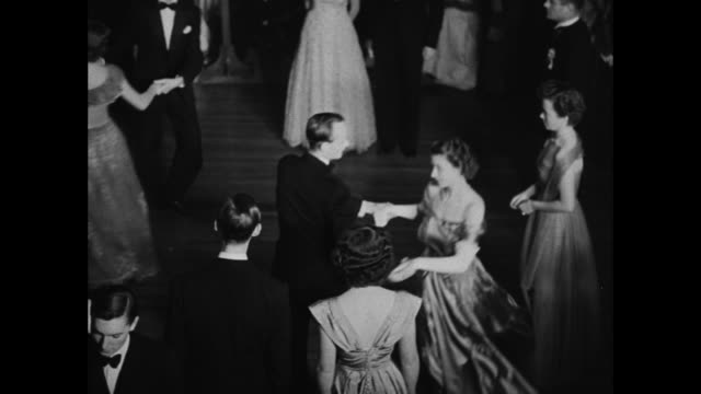 various shots of princess elizabeth and husband prince philip dancing with other dancers at square dance in ballroom in hotel phoenicia / note exact... - prince philip stock videos & royalty-free footage