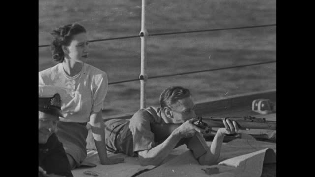 vidéos et rushes de various shots of princess elizabeth lying on deck of hms vanguard, aiming rifle on shipboard shooting range / queen elizabeth, wife of king george... - fusil