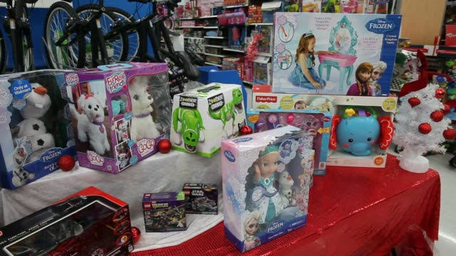stockvideo's en b-roll-footage met various shots of products for sale at a walmart in california, u.s., close up shot of a darth vader doll, wide shot of an aisle of racks with... - pop speelgoed
