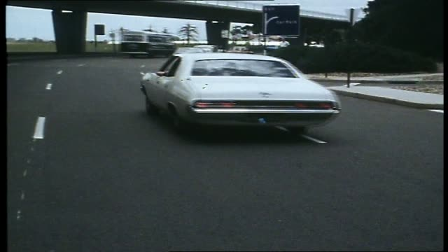"""various shots of progressive rock band """"yes"""" arriving at the airport: walking through the gates, loading their car and driving away / includes some... - anno 1973 video stock e b–roll"""