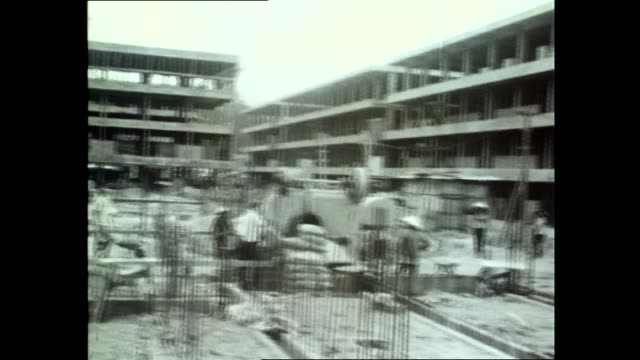 various shots of saigon military check points and traffic including military trucks and rickshaws motorbikes on the road / housing block for refugees... - traditionally vietnamese stock videos & royalty-free footage