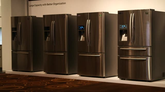 vídeos de stock, filmes e b-roll de various shots of samsung appliances at the 2014 consumer electronics show in las vegas nevada on january 8 wide panning shots of stainless steel... - medium group of objects