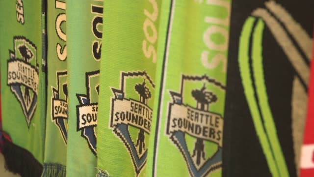 various shots of seattle sounders fc merchandise in seattle washington on march 19 a tight rack focus shot of green seattle sounders fc scarves a... - major league soccer stock videos and b-roll footage