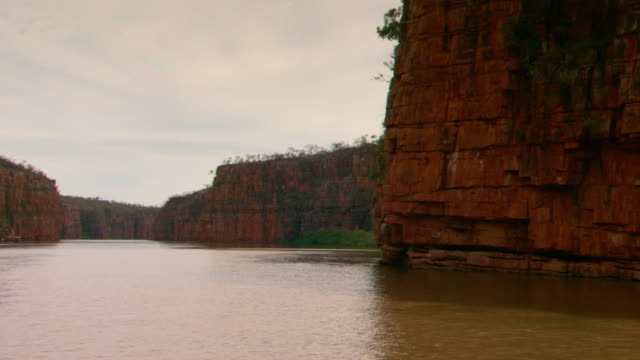 various shots of sedimentary sandstone rock the cliff face of the gorges on the berkeley river in the kimberley region point of view of a boat in the... - sedimentary rock stock videos & royalty-free footage