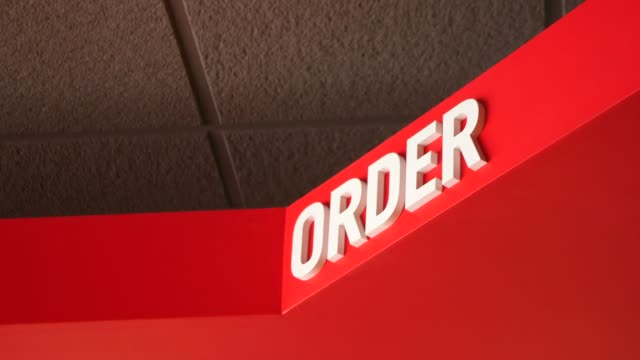 vídeos y material grabado en eventos de stock de various shots of signage and pictures inside of a dominos pizza in ann arbor, michigan on october 9 medium shots of red white and blue signage in a... - ann arbor