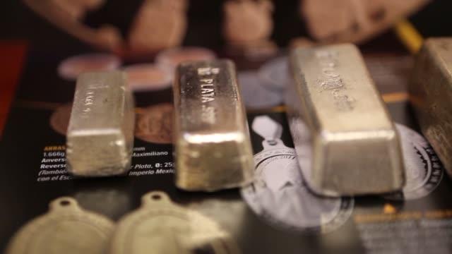 various shots of silver ingots at the casa de moneda mint in mexico city mexico on april 1 a tight shot of multiple silver ingots a tight panning... - barren geld und finanzen stock-videos und b-roll-filmmaterial
