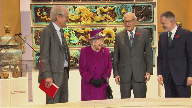 Various shots of Sir Richard Lambert Chairman of the Trustees of the British Museum presenting the Queen with a book and the Queen departing from the...