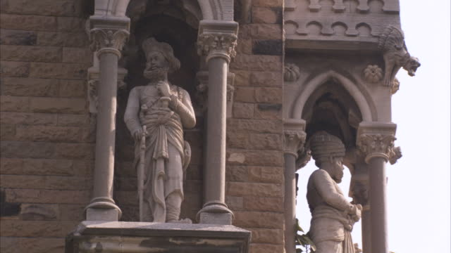 various shots of statues and decorative arches and pillars on the rajabai tower mumbai available in hd - gothic stock videos & royalty-free footage