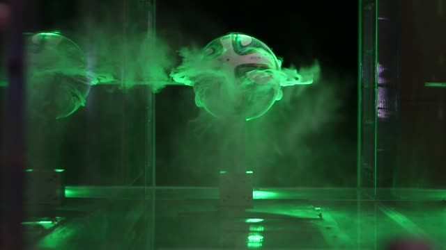 various shots of the 2014 world cup soccer ball, brazuca, having its aerodynamics tested in a nasa wind tunnel at the nasa fluid mechanics laboratory... - adidas stock videos & royalty-free footage