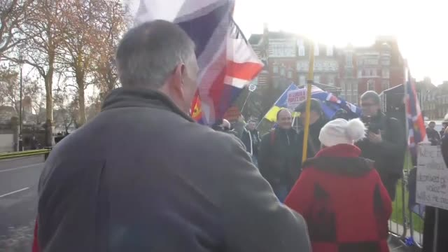 various shots of the anti-brexit and pro-brexit protesters demonstrate outside the westminster palace in london, united kingdom on december 11, 2018.... - protestor stock videos & royalty-free footage