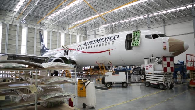 various shots of the boeing 737 aeromexico at the grupo aeromexico sab and delta air line inc facility in queretaro mexico on april 3 a wide panning... - tail wing stock videos and b-roll footage