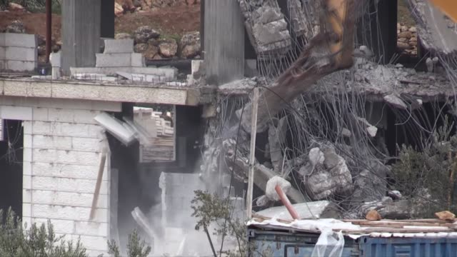 various shots of the bulldozers demolish two buildings belongs to palestinians under the observation of israeli forces with the claim of unauthorized... - west bank stock videos & royalty-free footage