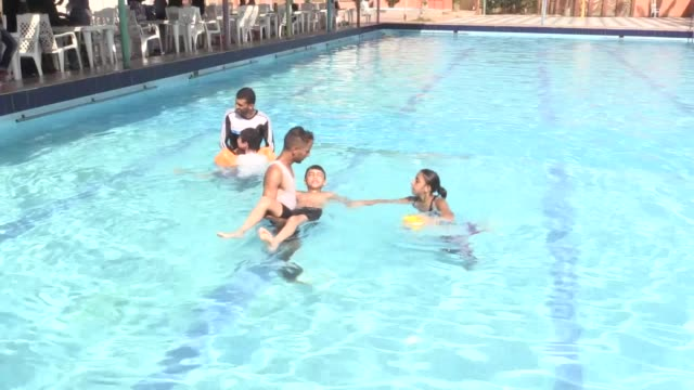 city gaza various shots of the children with autism during water therapy session in a swimming pool in gaza city gaza on august 08 2019 rim jarur... - 自閉症点の映像素材/bロール