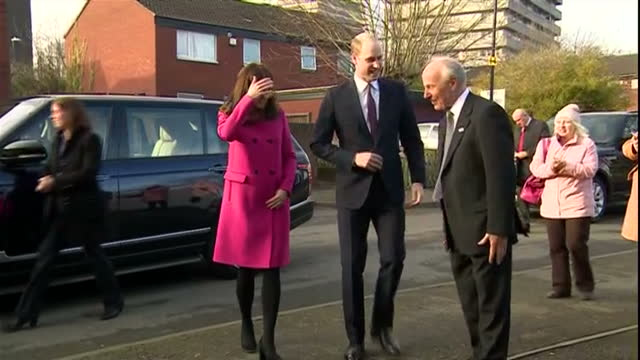 various shots of the duke and duchess of cambridge arriving to visit the positive youth foundation and being greeted by staff and local community... - visit stock videos & royalty-free footage