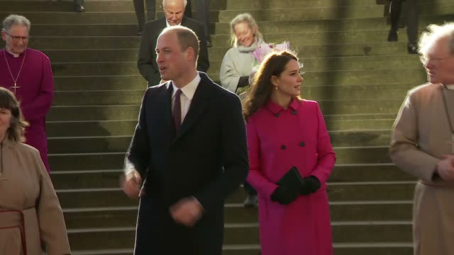 Various shots of the Duke and Duchess of Cambridge speaking with members of the clergy and officials and being presented with flowers by local...