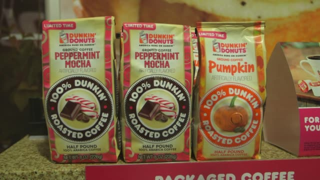 Various shots of the Dunkin Donuts store located in their headquarters in Canton Massachusetts on September 21 A wide panning shot from the menu to...
