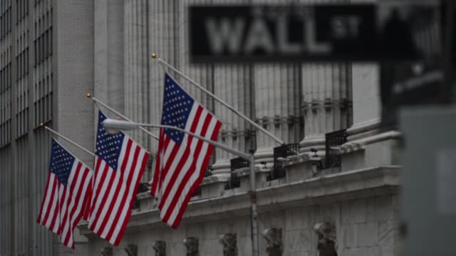 various shots of the exterior of the new york stock exchange exteriors on an a rainy day in lower manhattan, new york city, tight shots of the wall... - financial accessory stock videos & royalty-free footage