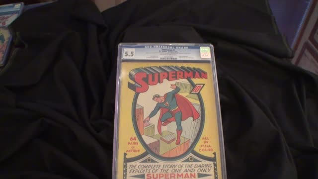 vídeos y material grabado en eventos de stock de various shots of the first superman dc comics comic book released in the summer of 1939 on display in new york city - superman superhéroe