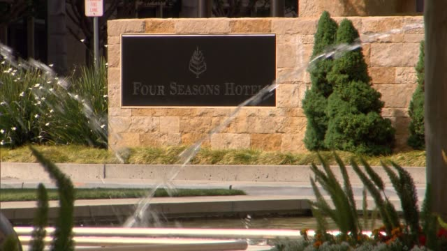 Various shots of the Four Seasons Hotel in East Palo Alto A tight shot of the Four Seasons Hotel sign with a fountain in the foreground A high angle...