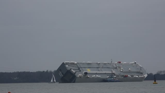 various shots of the hoegh osaka cargo ship that was deliberately grounded to prevent it from capsizing by the crew off of the isle of wight near... - isle of wight stock videos & royalty-free footage