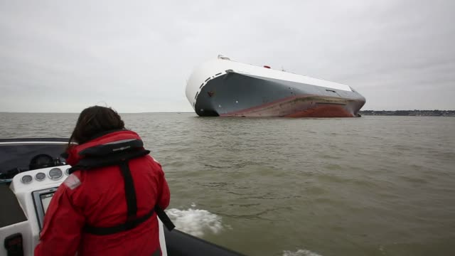 various shots of the hoegh osaka cargo ship that was deliberately grounded to prevent it from capsizing by the crew off of the isle of wight near... - insel wight stock-videos und b-roll-filmmaterial