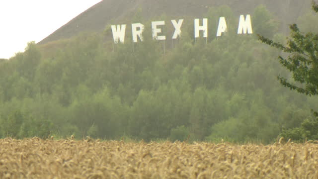 various shots of the large wrexham sign that has mysteriously appeared on a slag heap overlooking the town - western usa stock videos & royalty-free footage