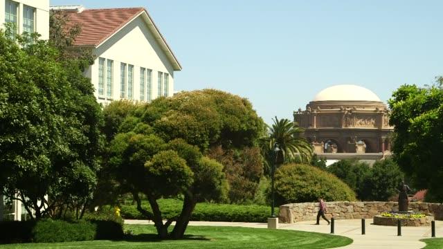 various shots of the lucasfilm ltd campus in san francisco california on a clear sunny day wide shots of a tree lined walkway on the lucasfilm ltd... - george lucas bildbanksvideor och videomaterial från bakom kulisserna