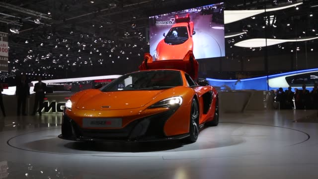 Various shots of the McLaren 650S at the 2014 Geneva Motor Show in Geneva Switzerland on March 4 A wide shot of a white sheet covering the 650S...