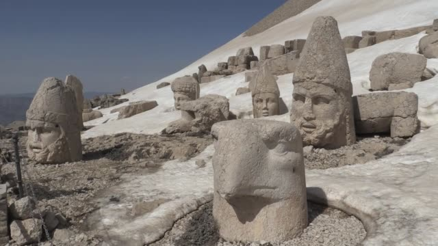 various shots of the mount nemrut as models pose for a photo shoot in kahta district of adiyaman southeastern turkey on april 03 2018 mount nemrut... - mountain pose stock videos and b-roll footage