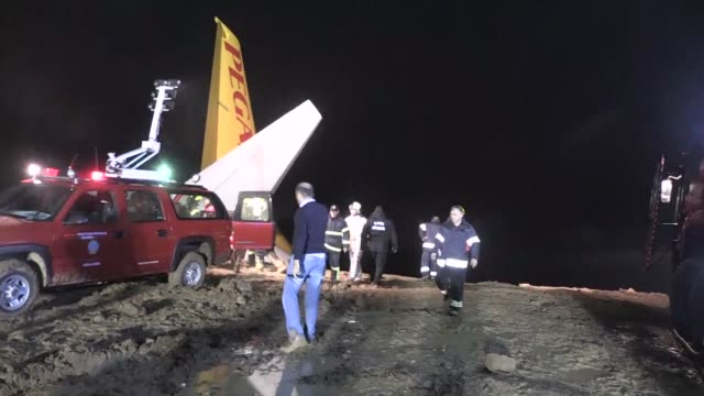 various shots of the pegasus airplane is seen stuck in mud as it skidded off the runway after landing in trabzon airport turkey early sunday on... - pegasus stock videos & royalty-free footage