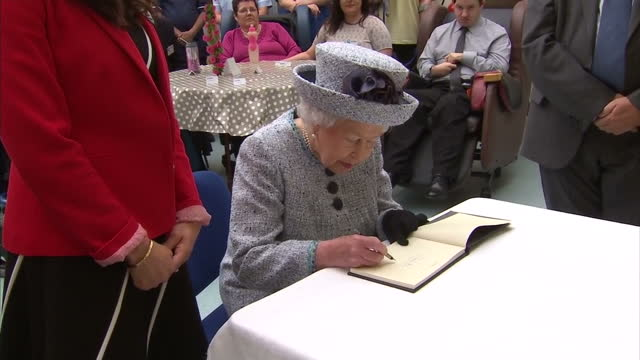 vídeos de stock, filmes e b-roll de various shots of the queen signing the visitors book and departing after a visit to sue ryder dee view court - 2017