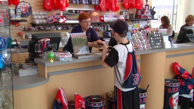various shots of the red sox team store and merchandise at jetblue park at fenway south the boston red soxs spring training facility in fort meyers... - spring training stock videos & royalty-free footage