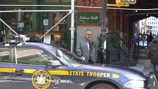 various shots of the scene outside of the building where a suspicious package mailed to actor robert de niro was discovered and removed by the new... - 疑念点の映像素材/bロール