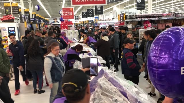 various shots of the shoppers are seen in the 'walmart' store during the sales on a 'black friday' in new york united states on november 22, 2018.... - black friday stock videos & royalty-free footage