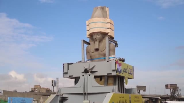 various shots of the statue of the ancient egyptian king ramses ii loaded onto a truck and transferred to its permanent display area at the atrium of... - pharaoh stock videos & royalty-free footage