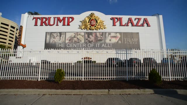 vídeos de stock, filmes e b-roll de various shots of the trump plaza in atlantic city new jersey on clear day a wide street level shot of the trump plaza façade as traffic passes by on... - atlantic city
