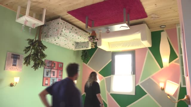 stockvideo's en b-roll-footage met various shots of the upside down house in ankara turkey on may 13 2017 not only its exterior appearance but also interior decoration of the house its... - op z'n kop