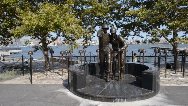 various shots of the world war ii memorial statue near sinatra park in hoboken, new jersey - world war ii stock-videos und b-roll-filmmaterial