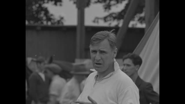 various shots of tommy hitchcock jr and another man strapping on his kneepads before international polo cup game at meadowbrook polo club handlers... - old westbury stock videos and b-roll footage