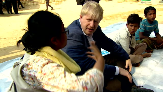 various shots of uk foreign secretary boris johnson speaking to rohingya children at a refugee camp on february 10 2018 in cox's bazaar bangladesh - cox's bazaar stock videos and b-roll footage