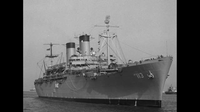 stockvideo's en b-roll-footage met various shots of united states navy troopship uss general h. w. butner with tugboat on its left side / three quarter front view of uss general h. w.... - quarter