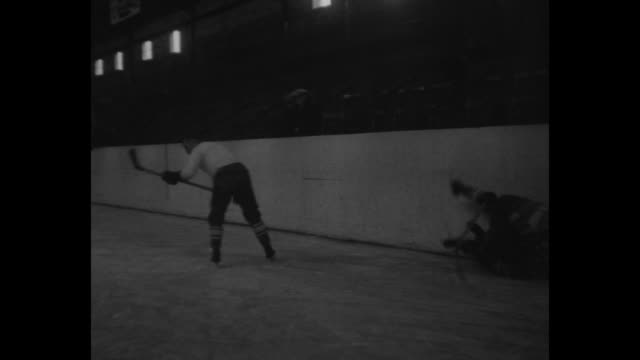 Various shots of US hockey players practicing on ice rink in Galt Ontario / Note exact day not known