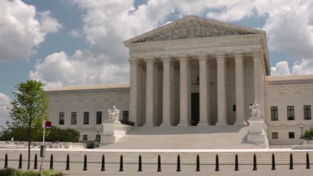 various shots of us scotus during coronavirus, people visit wearing masks, quiet surrounding streets - us supreme court building stock videos & royalty-free footage