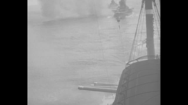 vidéos et rushes de various shots of warships firing guns during fleet review / note: [exact month/day not known] - royal navy