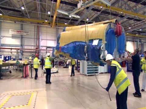 vidéos et rushes de various shots of workers in a fighter plane factory. - aéronautique