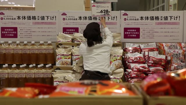 various shots of workers preparing shelf displays at an aeon co supermarket in chiba japan on march 31 a wide shot of a female worker organizing... - dry stock videos & royalty-free footage