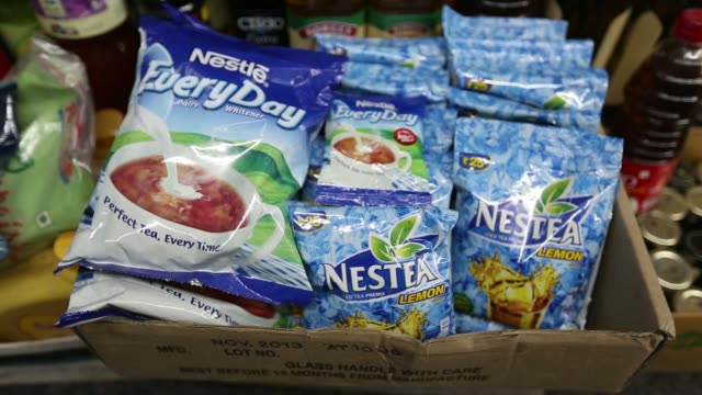 various shots packets of nestle everyday dairy whitener and nestea lemon iced tea premix both manufactured by nestle india ltd are displayed for sale... - portionspåse bildbanksvideor och videomaterial från bakom kulisserna
