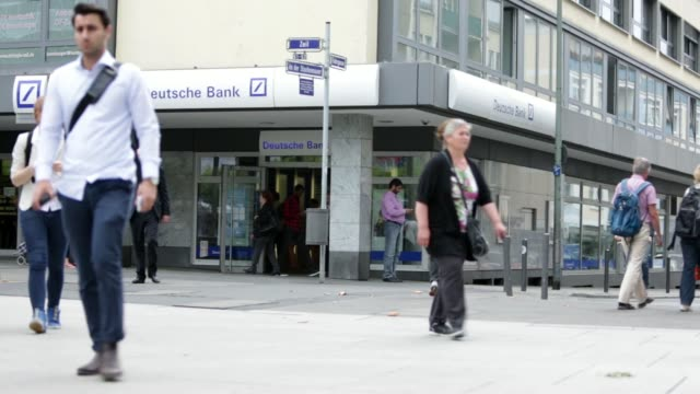 various shots pedestrians and cyclists pass a deutsche bank ag branch in frankfurt germany on friday june 20 various shots deutsche bank signage and... - deutsche bank stock videos & royalty-free footage